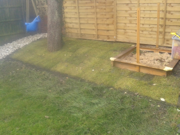New lawn and white pebbles installed