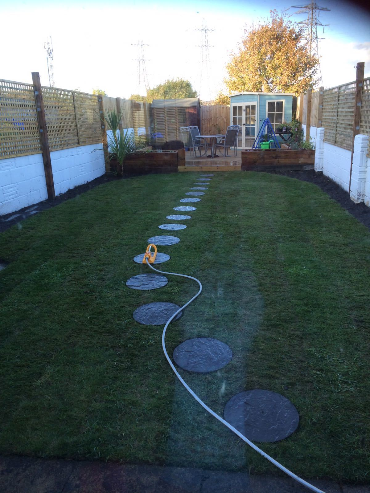 Turfed and stepping stones laid